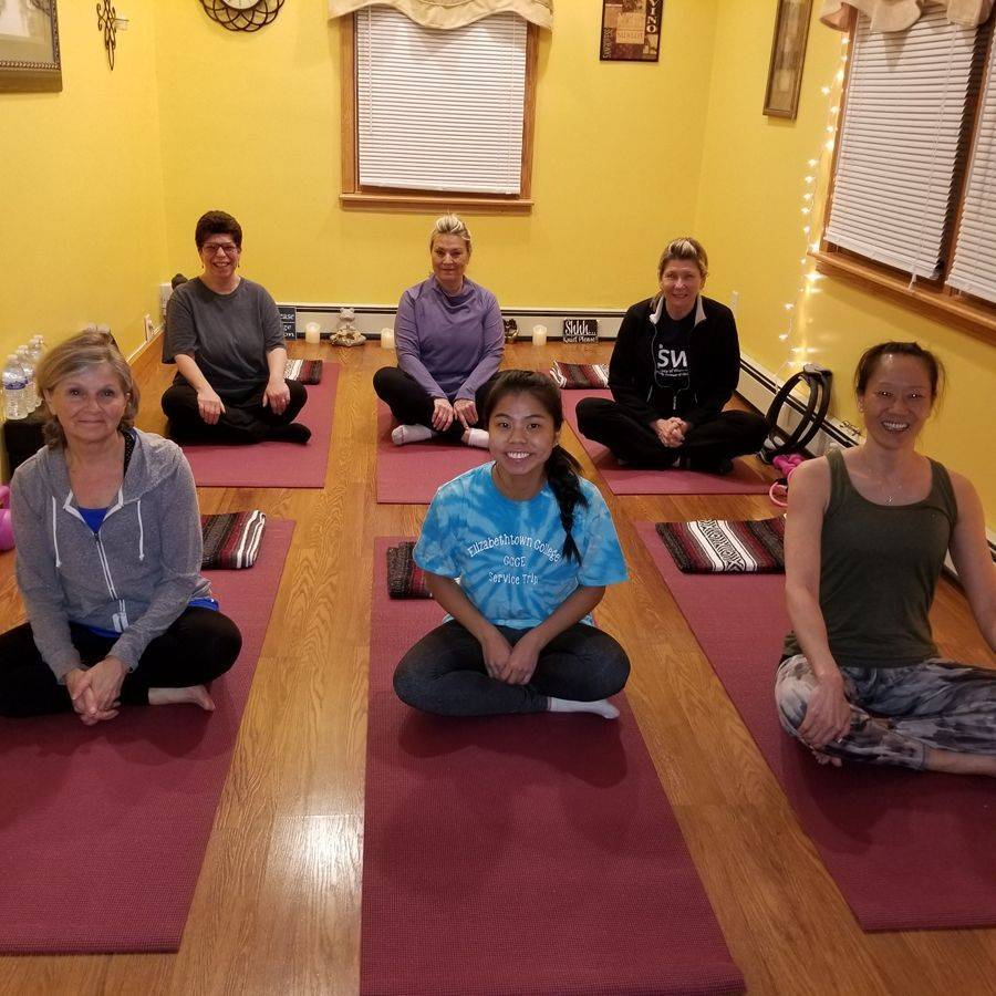 Women in extended hand-to-toe pose