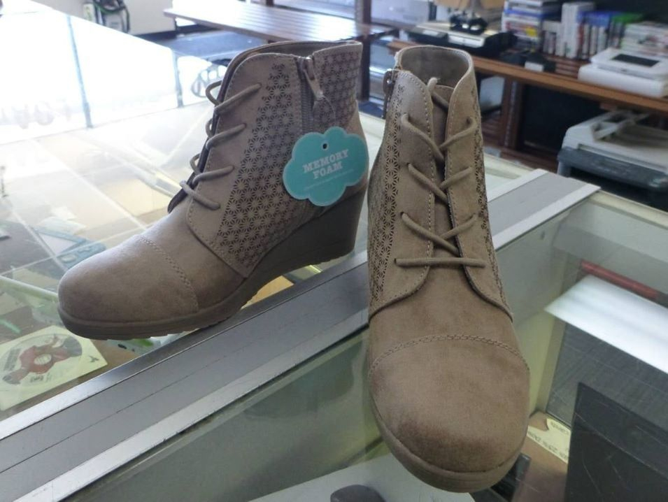 pair of Girls Brown lace up ankle high wedge boots