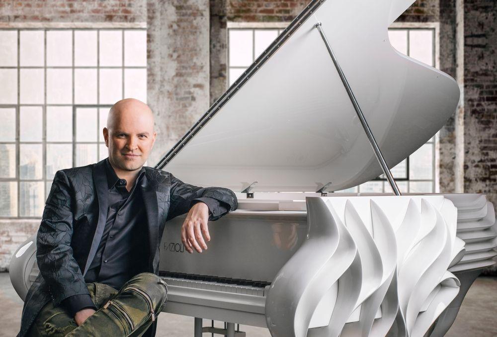 Canadian composer Martin Mayer sitting at his piano