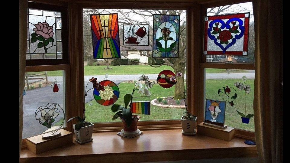Front window with a collection of stained glass pieces