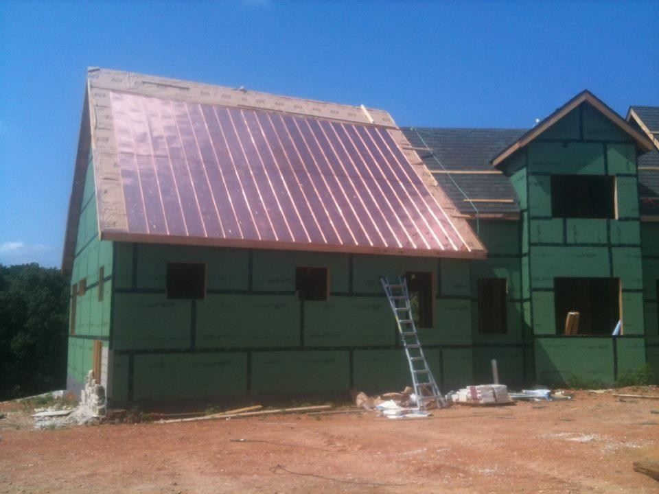 standing seem copper installation by ABC Roofing for Ramsey building co.