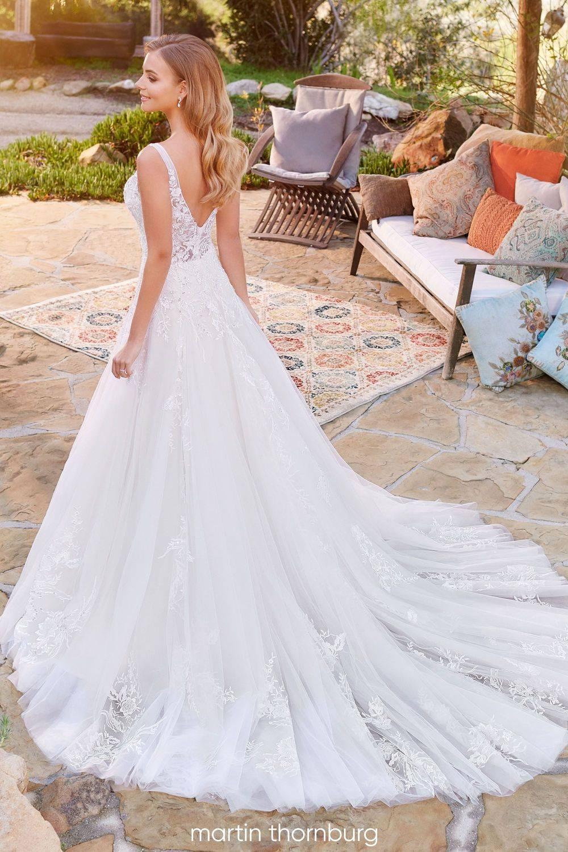 lace v back wedding dress with gorgeous chapel length train