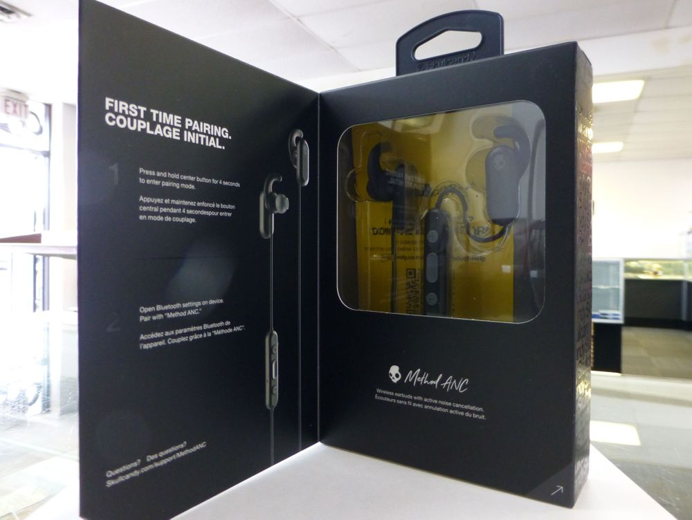 Closeup picture of a pair of Skullcandy wireless earbuds in original packaging