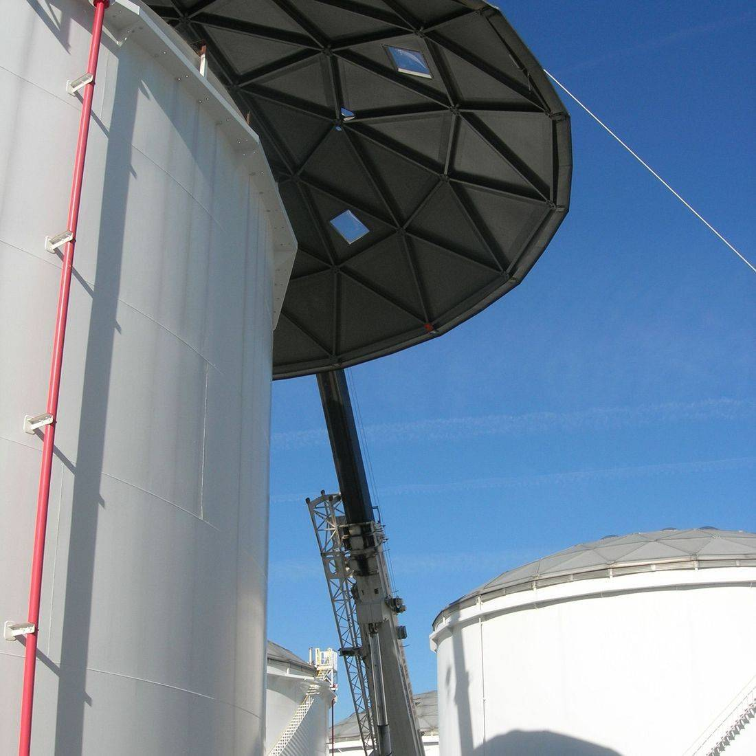 API 653 Storage Tank repair project; Lowering of geodome from welded steel storage tank for dismantling at ground level.