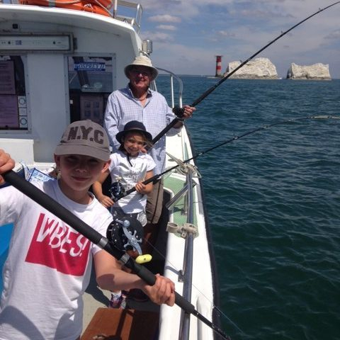 Family mackerel fishing with Needles lighthouse in the background