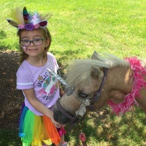 little girl and unicorn