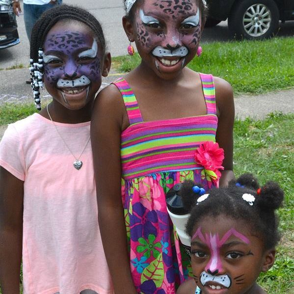 three little girls with face paint on