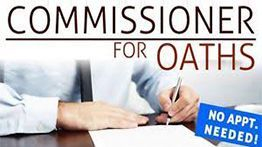 Commissioner for Oaths signning papers