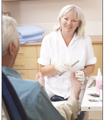 Image of a footcare nurse tending to a patient