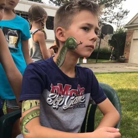boy with a snake face paint