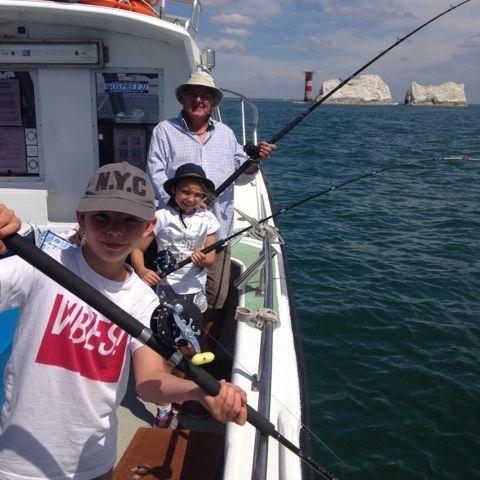 Family mackerel fishing by Needles lighthouse