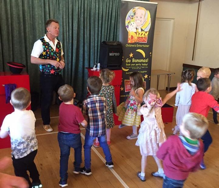 Children's Entertainer and magician doing party games before the show