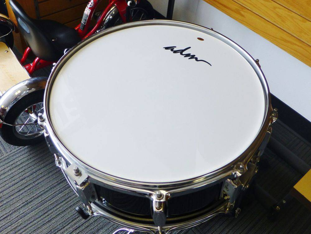 close up picture of an ADM snare drum on a stand