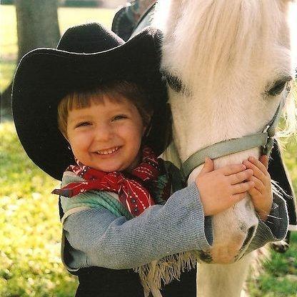 Little boy riding pony
