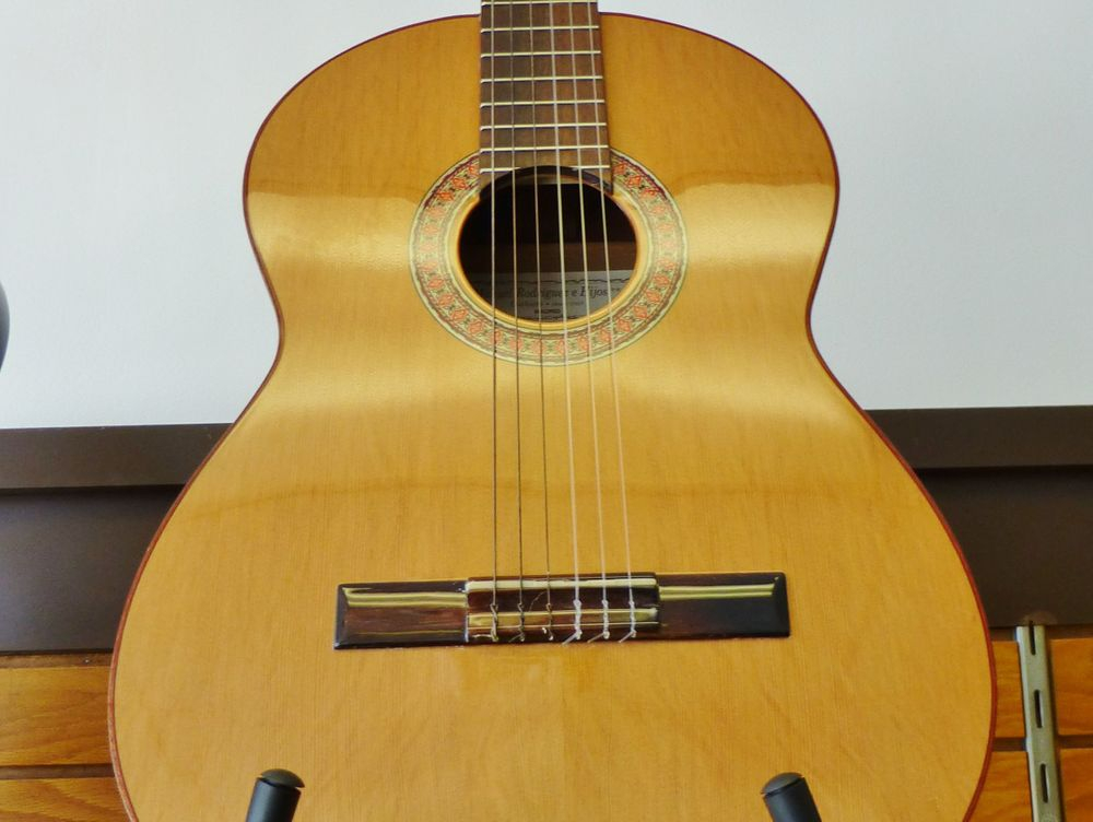 close up picture of an acoustic guitar on a stand