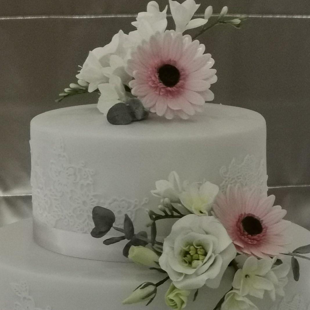 Three Tiered Wedding Cake with handcrafted Gerberas,Lisianthus, Freesia & Eucalyptus