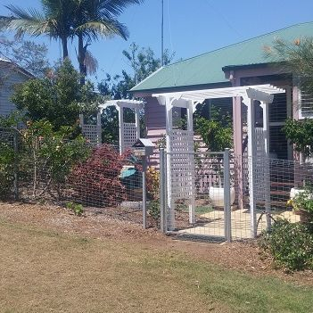 Completed white arbors at property in Gympie by Gympie Home Handyman, Gardening & Maintenance Services