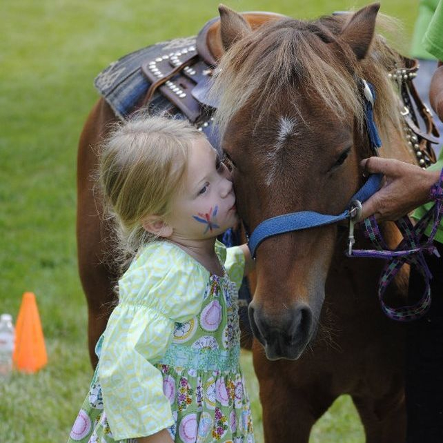 Little Girl Kissing brown pony