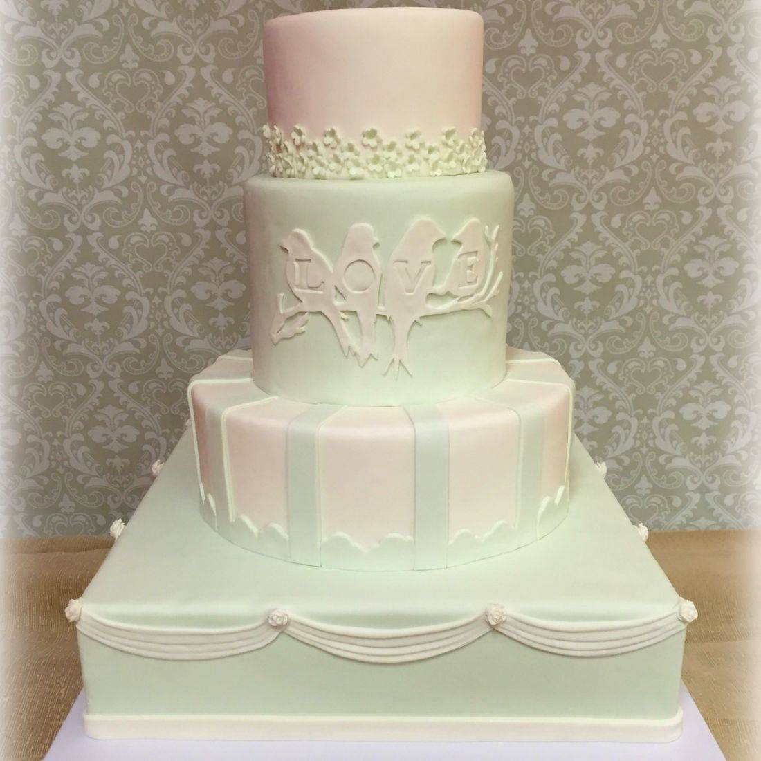 Wedding cake sweet love birds mint green and white flowers