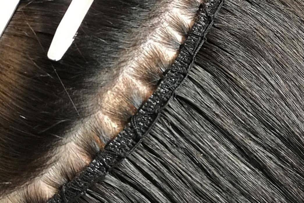 Close Up of The Remi Cachet Hollywood Weave Fitted