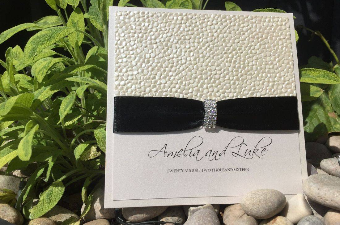 Luxury personalised Wedding Invitations with Pebble Paper design and diamond Jewell