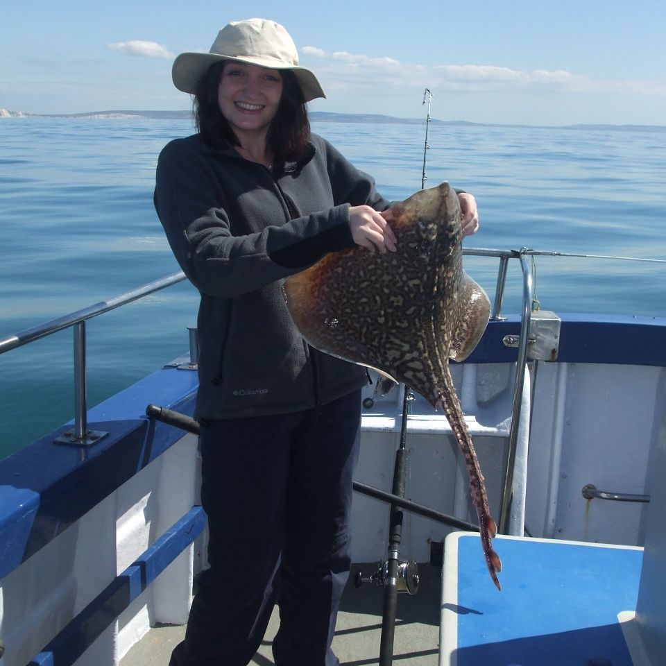 Woman holding a Thornback Ray