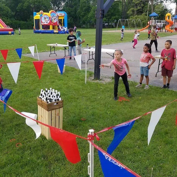 Kids playing ring toss game