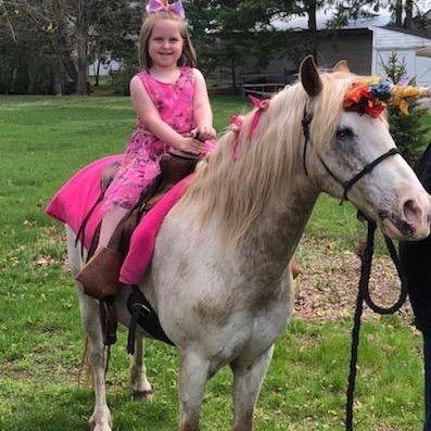 Little girl on unicorn
