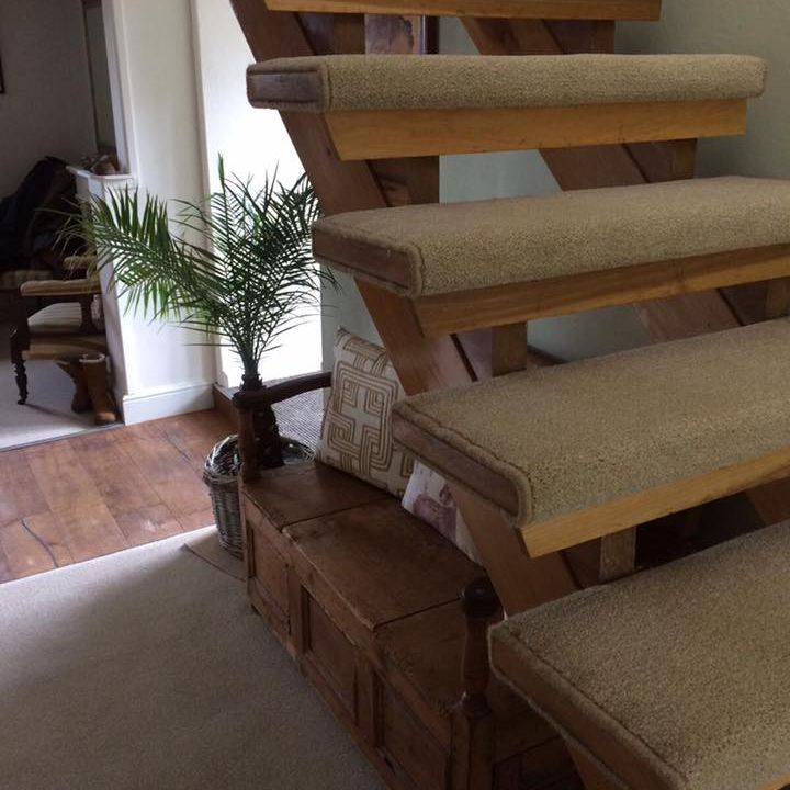 Wrap around beige Stairs carpet fitted on open staircase