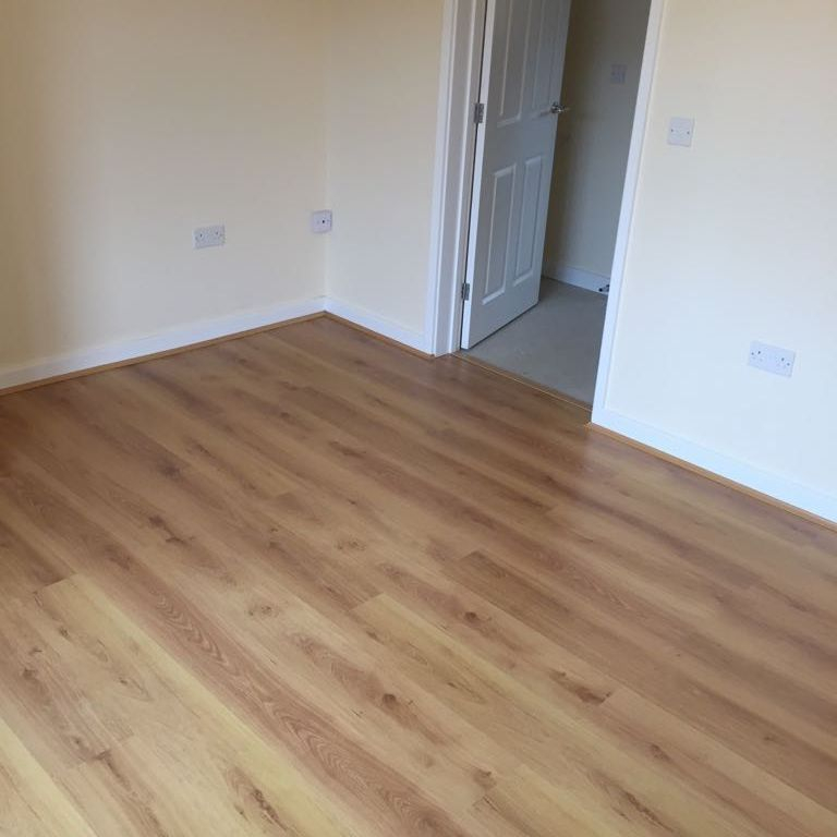 Mid Oak Laminate fitted in a room