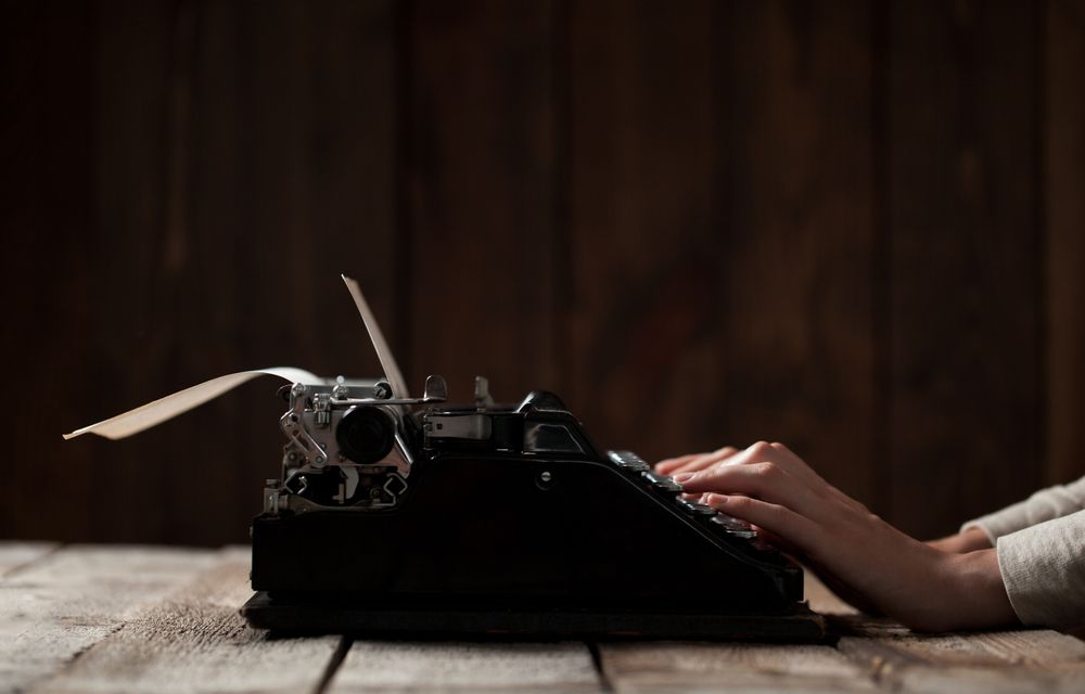 A typewriter, illustrating original written content