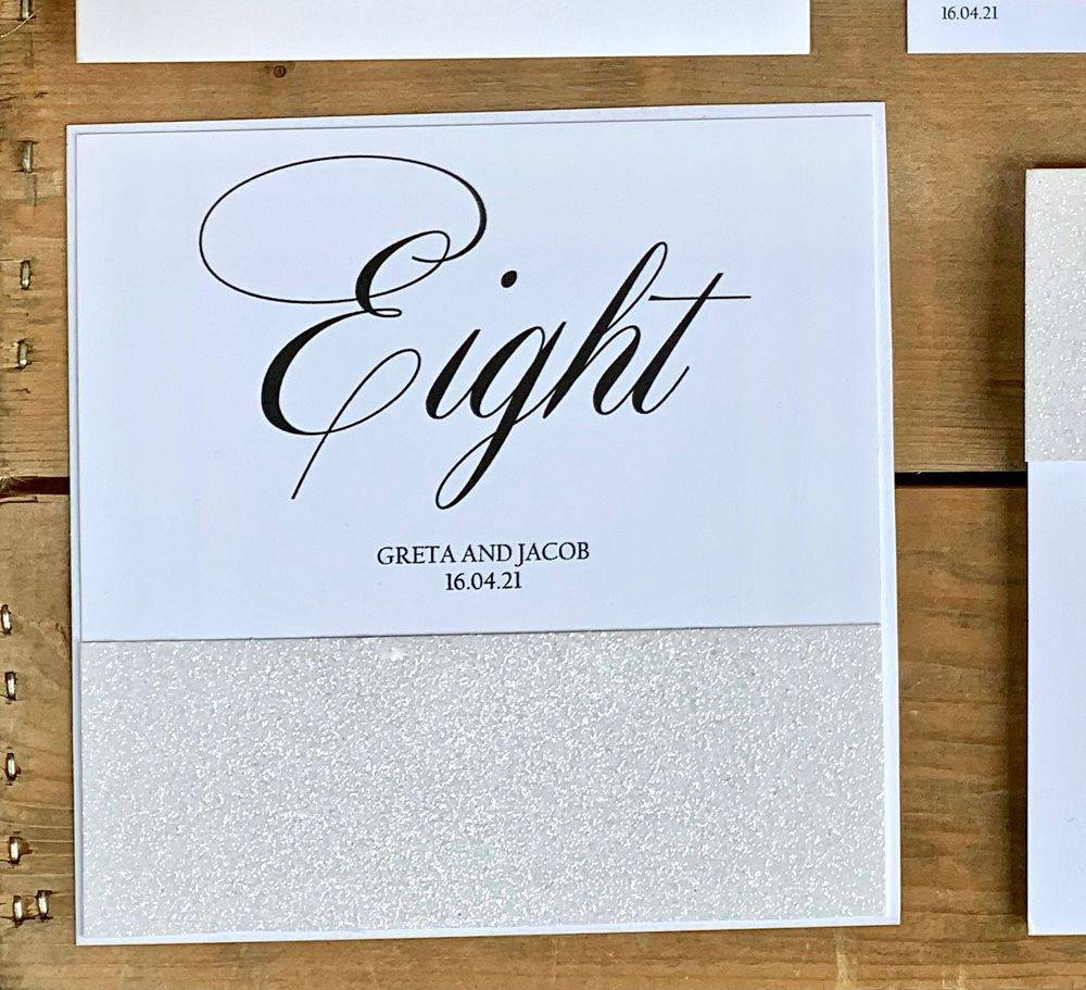 White glitter table number card
