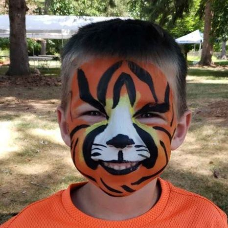 Little boy with tiger face paint