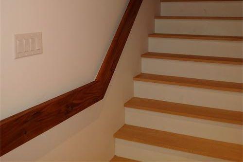 Walnut handrail in stairway in mid-century modern home renovation