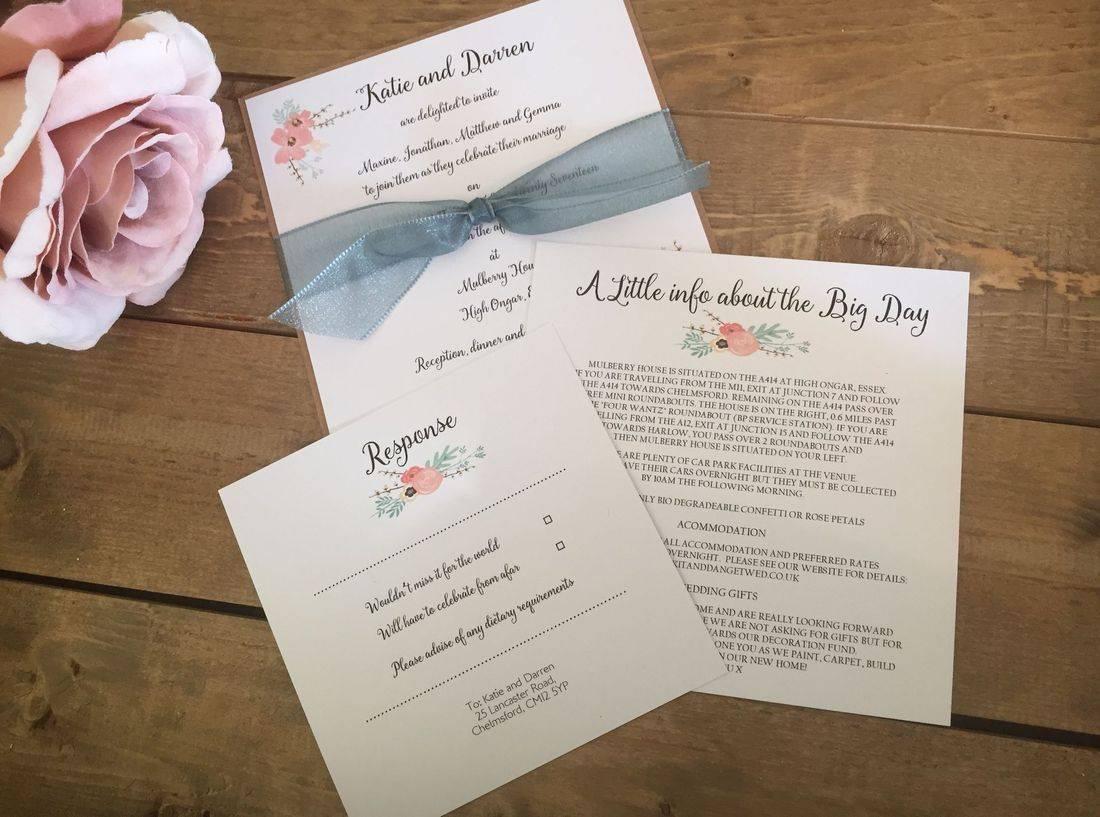 Ribbon tied wedding invitation