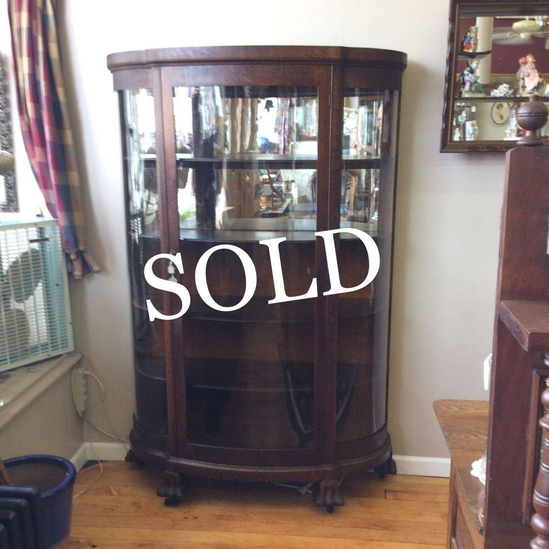 "C. 1890's - 1910 Oak Curved Glass, 4-Shelf China Cabinet w/1/2 Mirror Backing and Carved Claw Feet  47""W x 16""D x 67""H.  $375.00"
