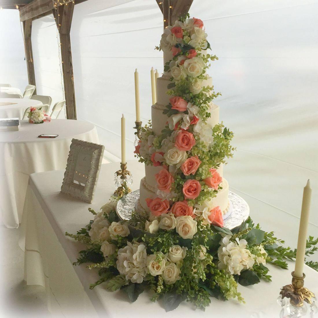 Wedding cake lush fresh flowers