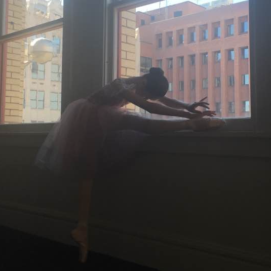A graceful stretch before performance.