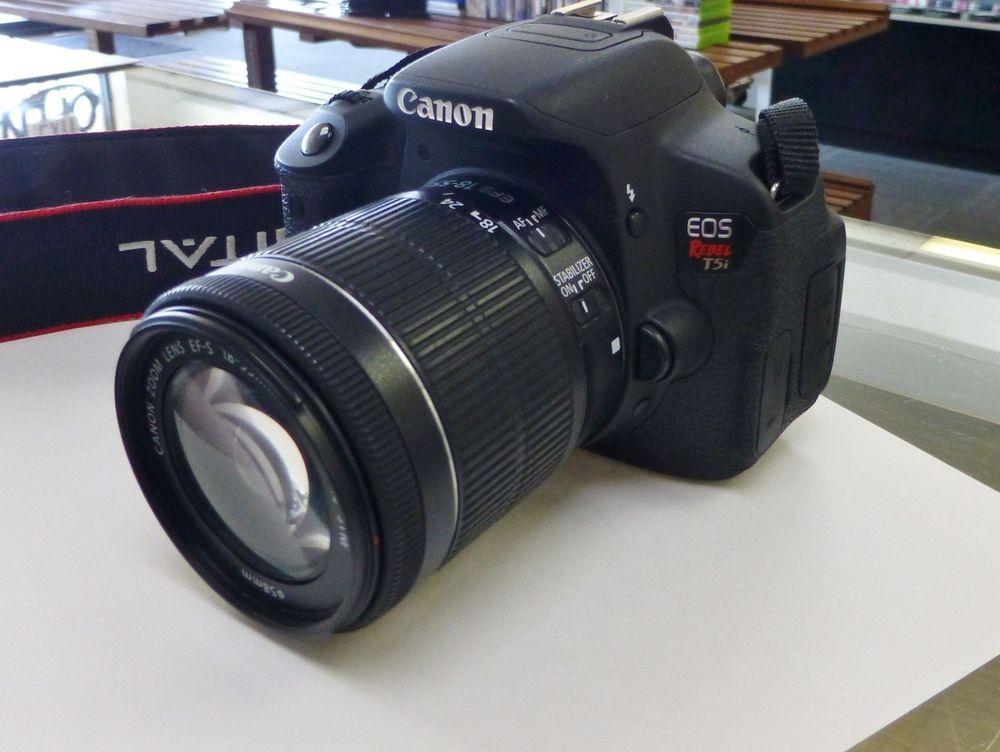 close up picture of a black Canon Rebel T5i Digital SLR camera