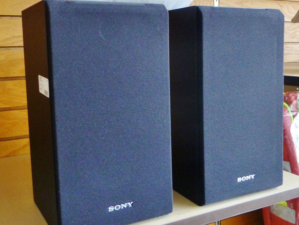 close up picture of a pair of black bookshelf speakers