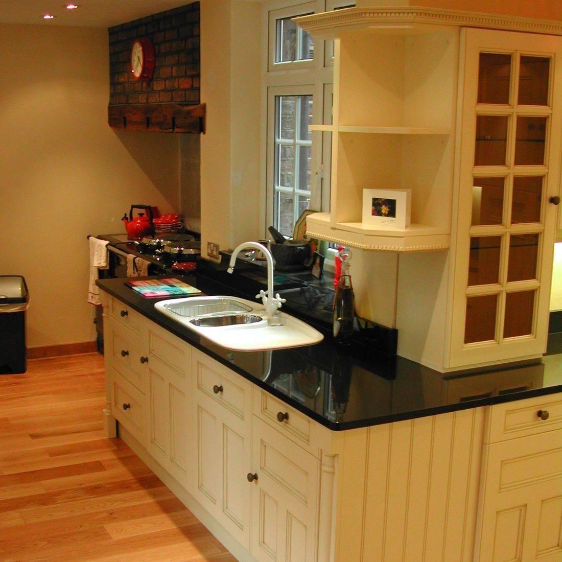 cream kitchen black granite worktops white sink