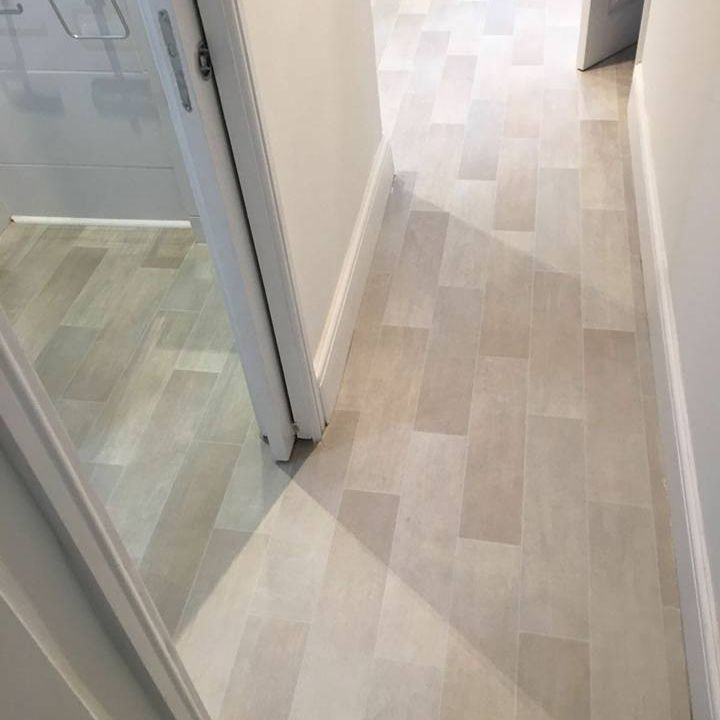 Grey wood effect Vinyl fitted in bathroom and hallway