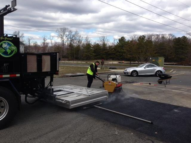 patching road surface with infrared equipment