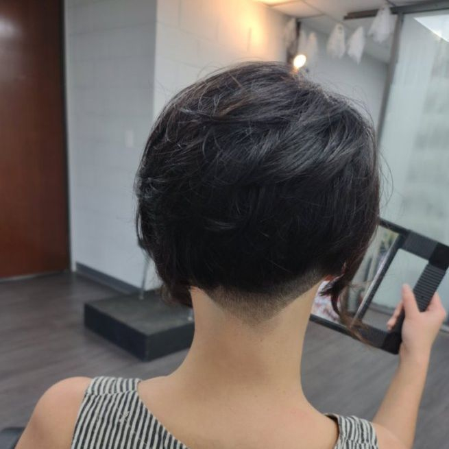 short unisex pixie razor haircut faded tapered hairline