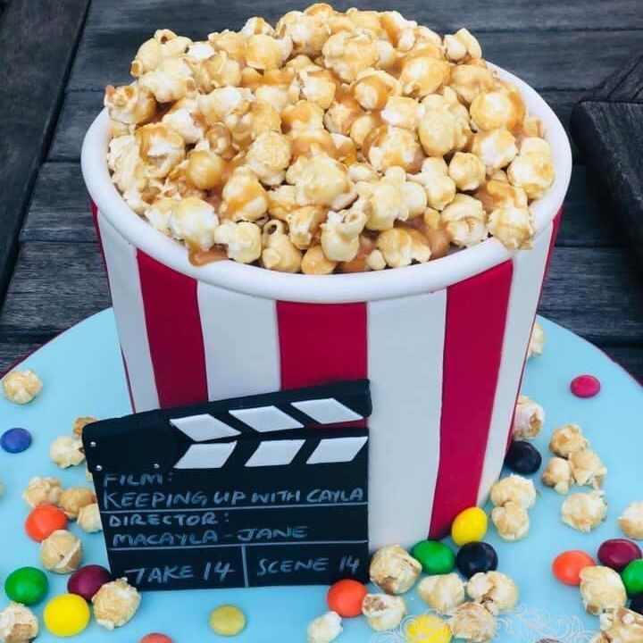 movies film birthday cake clapper board popcorn bucket sweets treats