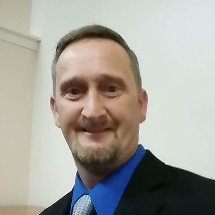 Minister Ken Posey
