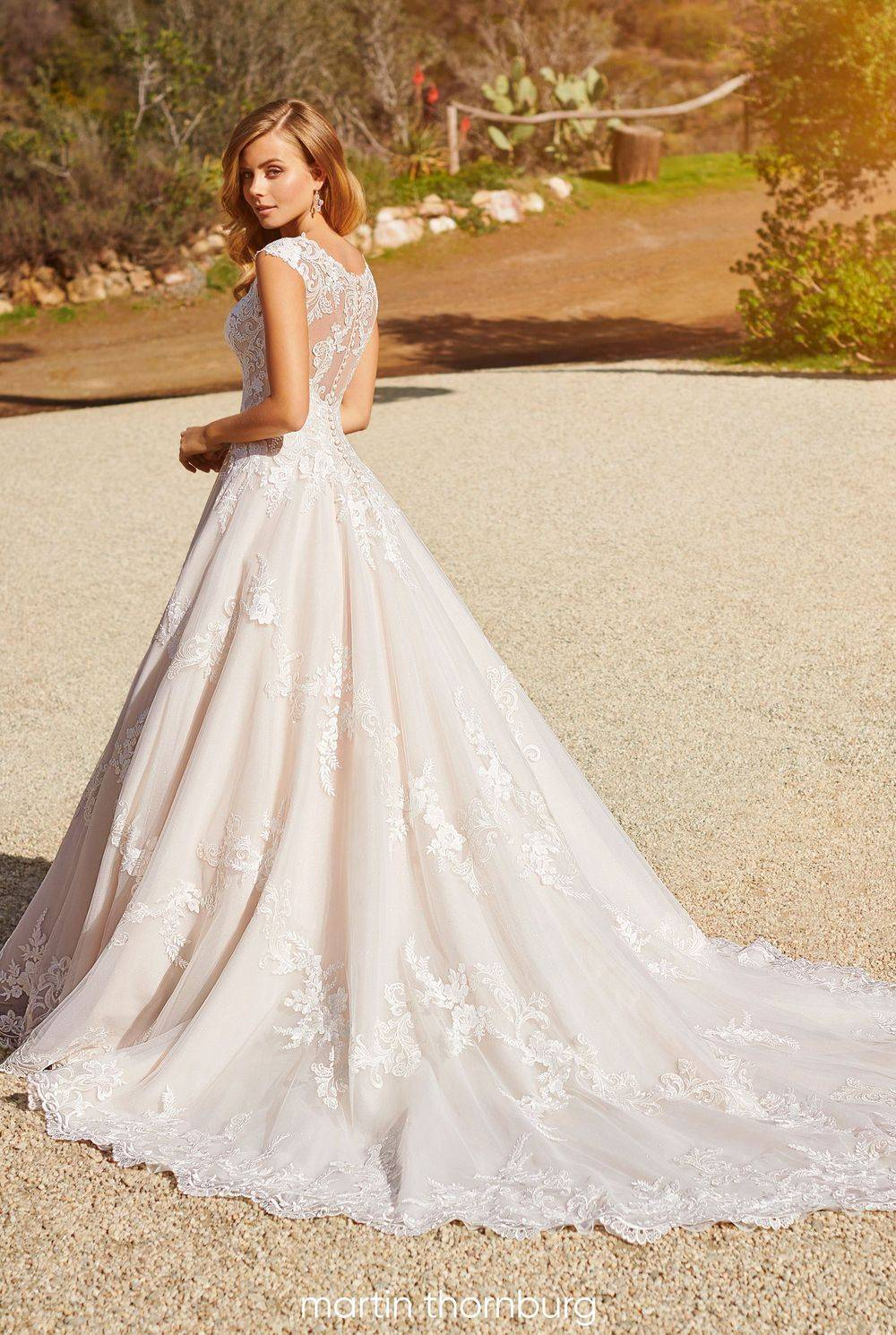 Beautiful lace over sparkle tulle A-line gown with sweetheart bodice
