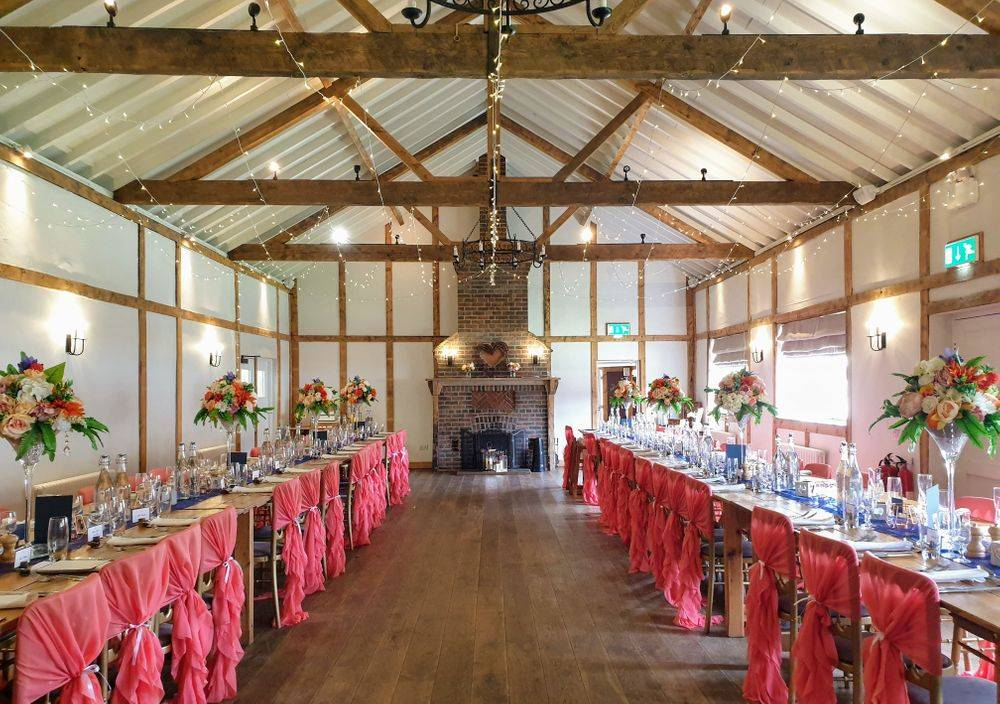 Coral and navy wedding reception  styling by Love By Design Weddings at Burley Manor Barn