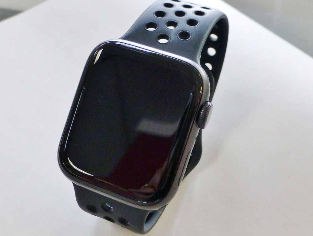 close up picture of a black Apple watch on a white background