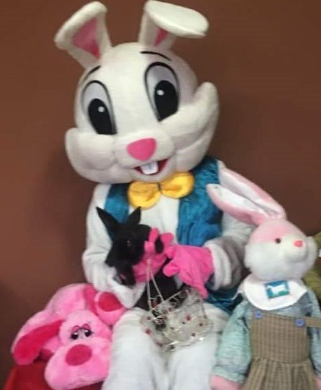 Costume Easter Bunny Character holding live bunny